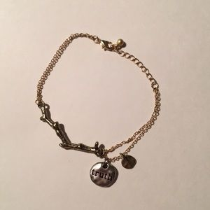 Bracelet with branch and truth charm